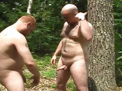 Two fattys having some wild sew in the forest.